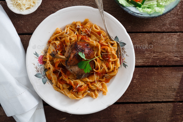 Italian homemade pasta, pappardelle with tomato sauce and braised rabbit, top view close-up - Stock Photo - Images