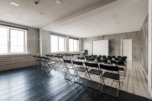 Empty modern classroom with black chairs projector screen - Stock Photo - Images