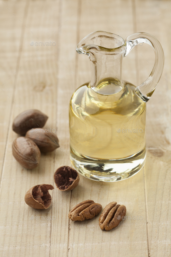 Glass can with pecan oil - Stock Photo - Images