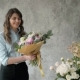 Portrait of Happy Female Florist with Bouquet Roses and Peone Looking at Camera