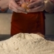 Cook Throw an Egg on a Pile of Flour In the Kitchen of a Pizzeria - VideoHive Item for Sale