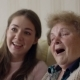 Beautiful Granny and Her Granddaughter Are Doing Selfie, Looking at Camera and Smiling While Sitting - VideoHive Item for Sale