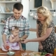 Family Eating Healthy Breakfast in Kitchen, Happy Family Mom Mother and Dad Father with Little Girl