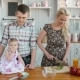 Happy Young Family Cooking in Kitchen at Home, Vegetables Salad and Fruits, Healthy Breakfast