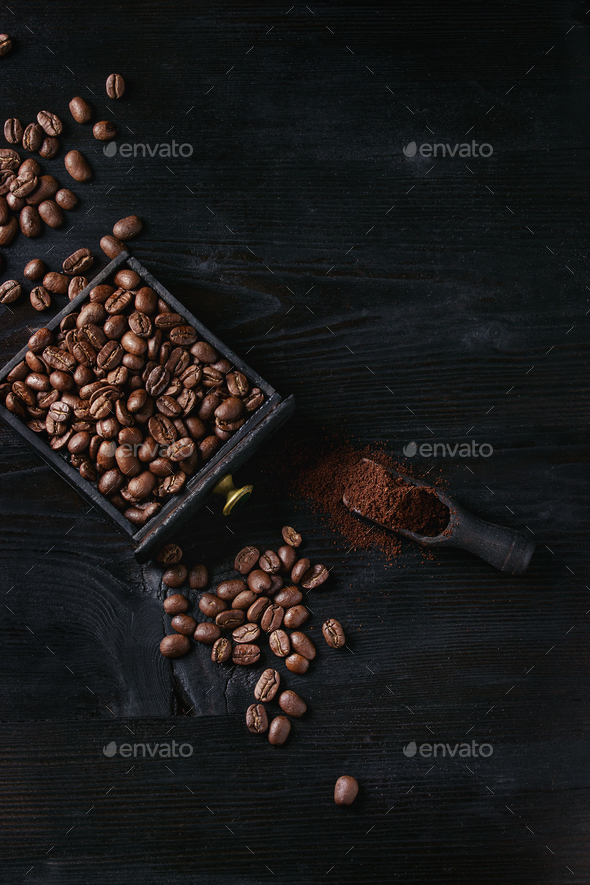 Roasted coffee beans over black - Stock Photo - Images