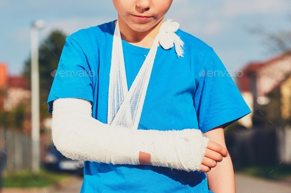 Boy with broken hand - Stock Photo - Images