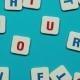 Word Tour Formed of Blue and Red Letters on the Skyblue Background. Stop Motion