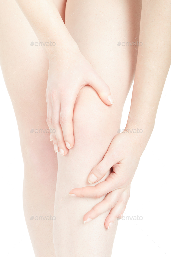 Young woman knee close up with hands isolated on white, clipping - Stock Photo - Images