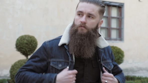 VideoHive Portrait of Bearded Male with Long Hair Dressed in a Denim Jacket 19755832