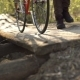 Cyclist Walking in the Park Crossing the River on a Wooden Bridge - VideoHive Item for Sale