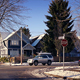 Cars Passing Houses In Snow On Sunny Day - VideoHive Item for Sale