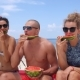 Happy Friends Eating Watermelon on Beach on Vacation