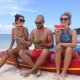 Two Women and Handsome Man Having Fun on Beach