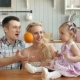 Mother Father and Daughter Cooking Dinner in Kitchen, Happy Family, Mom Dad and Child Girl Morning