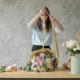 Florist at Work: Pretty Young Blond Woman Holds Fashion Modern Bouquet of Different Flowers with