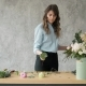 People, Business, Sale and Floristry Concept - Happy Smiling Florist Woman Making Bunch at Flower