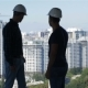 Two Builders Look at the Landscape of High Buildings - VideoHive Item for Sale