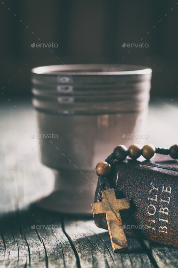 Rosary beads, holy bible and cup of wine. - Stock Photo - Images