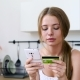 Vibrant Lady with Cellphone and Bank Plastic Card at Kitchen