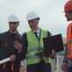 Men on Building Site Discussing the Blueprint - VideoHive Item for Sale