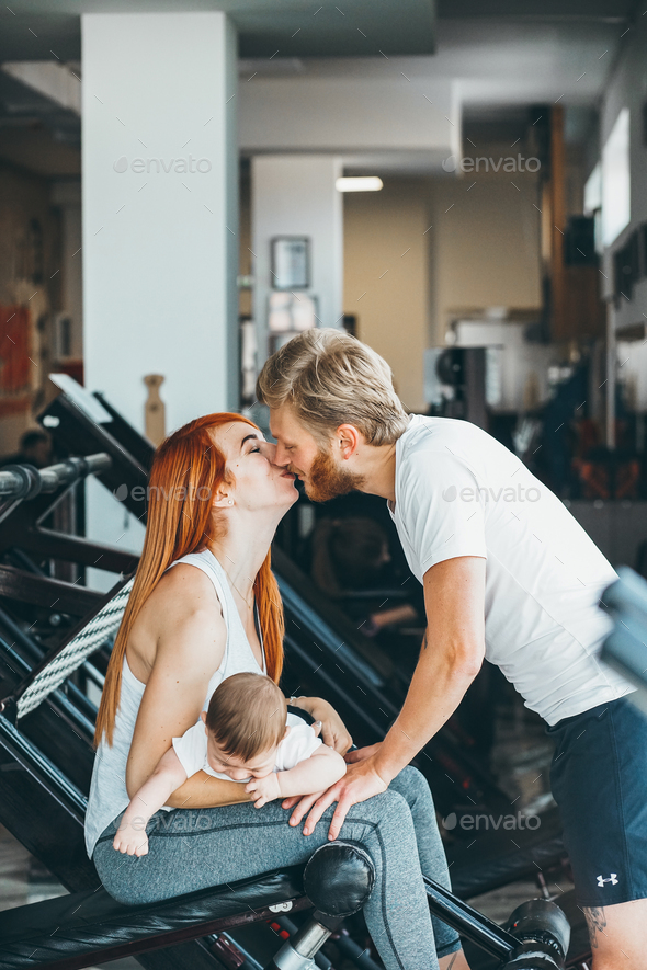 Young family with little boy in the gym - Stock Photo - Images