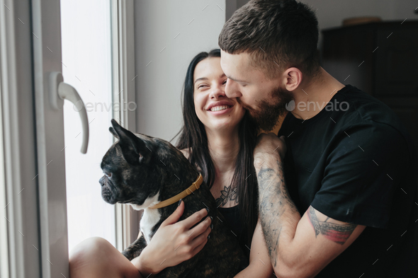 happy couple and a dog at home - Stock Photo - Images