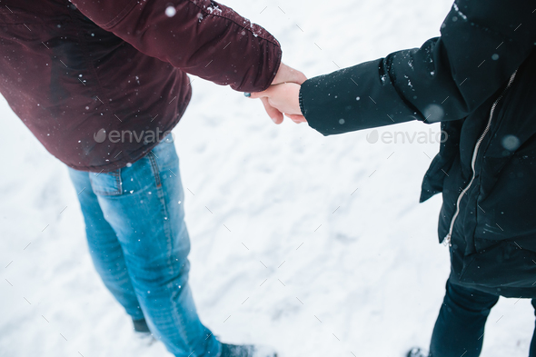Couple holding hands - Stock Photo - Images