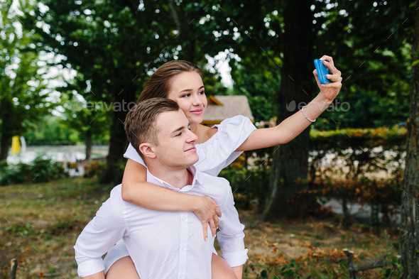 Beautiful young couple makes selfie - Stock Photo - Images