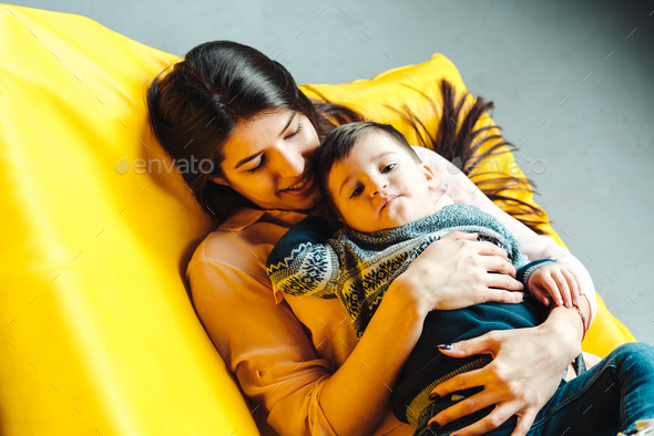 Mother and little son play at home - Stock Photo - Images