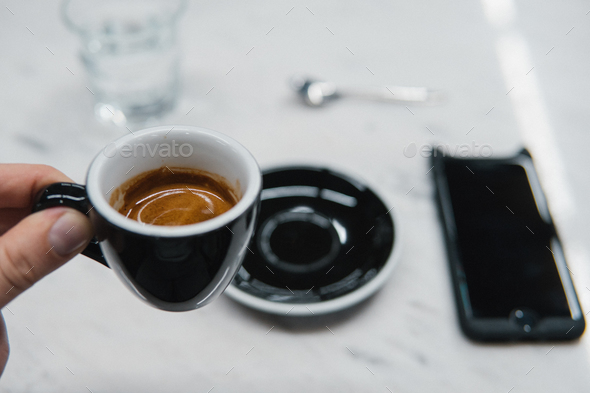 cup of coffee in a hand - Stock Photo - Images