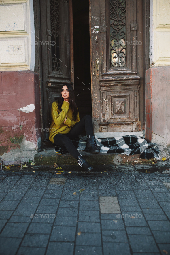 beautiful woman near the old doors - Stock Photo - Images