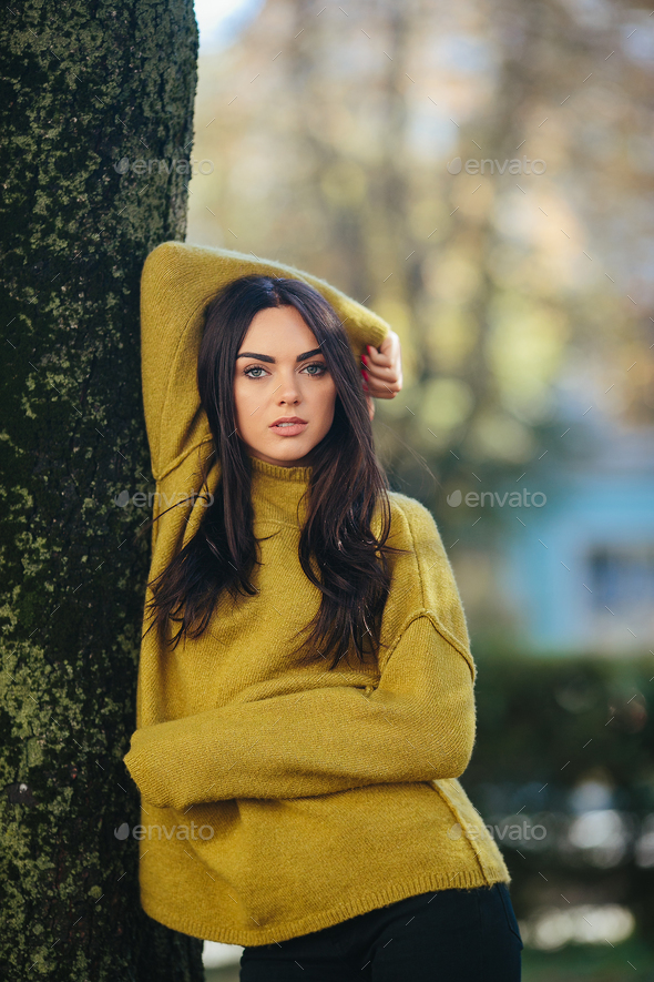 Fashion girl posing in the park - Stock Photo - Images