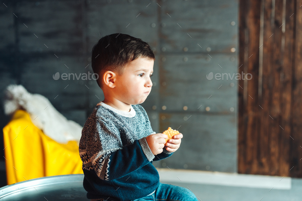 little boy eating delicious cookies - Stock Photo - Images