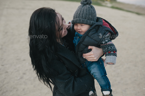 Young mother and her son outdoor - Stock Photo - Images