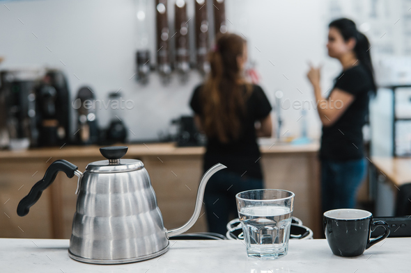 cup with coffee near a glass of water and tea - Stock Photo - Images