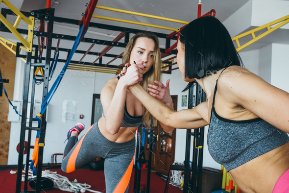 Two beautiful girls together in a fitness room - Stock Photo - Images