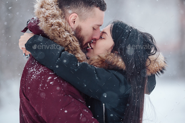 Beautiful young couple kissing - Stock Photo - Images