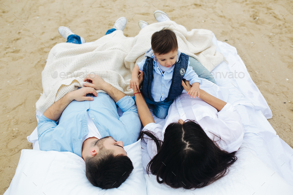 Happy family relaxing together on the mattress - Stock Photo - Images