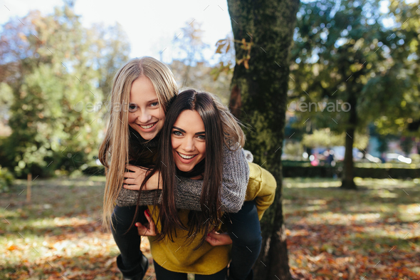 Two girls having fun in the park - Stock Photo - Images