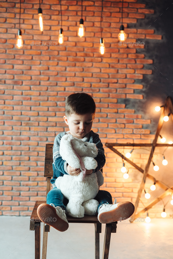 little boy sitting on a chair - Stock Photo - Images