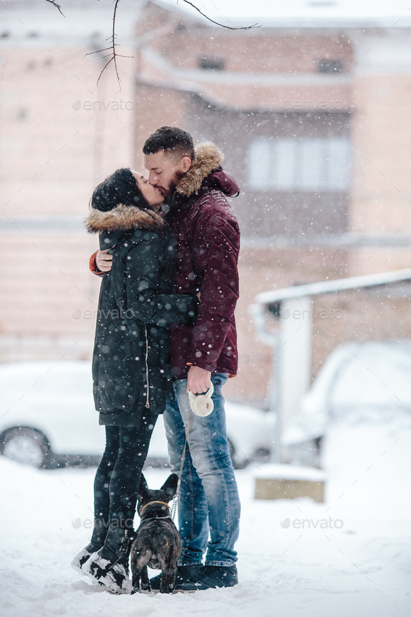 couple posing on a snowy street - Stock Photo - Images