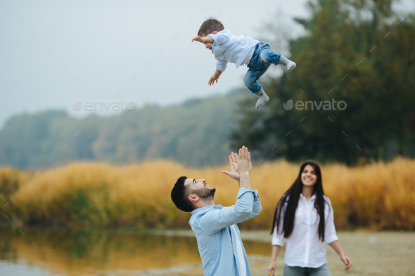 Dad throws up his young son - Stock Photo - Images