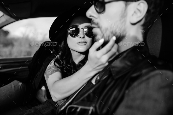 Portrait of young beautiful couple in the car - Stock Photo - Images