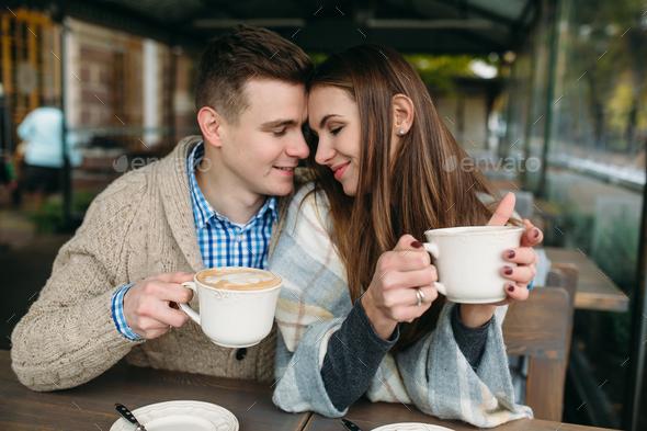Couple sitting at sidewalk cafe - Stock Photo - Images