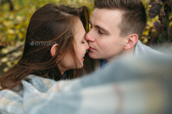 Young couple at the park in autumn season - Stock Photo - Images