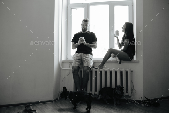 couple on the background of a window - Stock Photo - Images