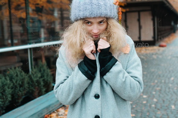 Woman in an autumnal landscape - Stock Photo - Images