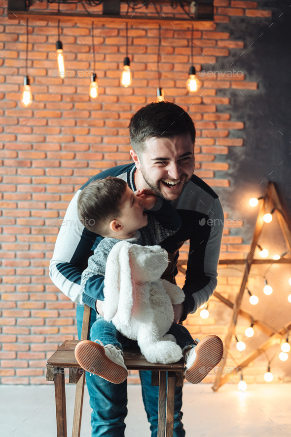 Dad and son on a background of a brick wall - Stock Photo - Images
