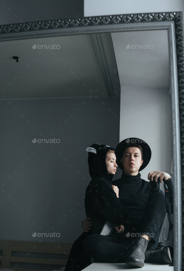 man and woman in black clothes - Stock Photo - Images