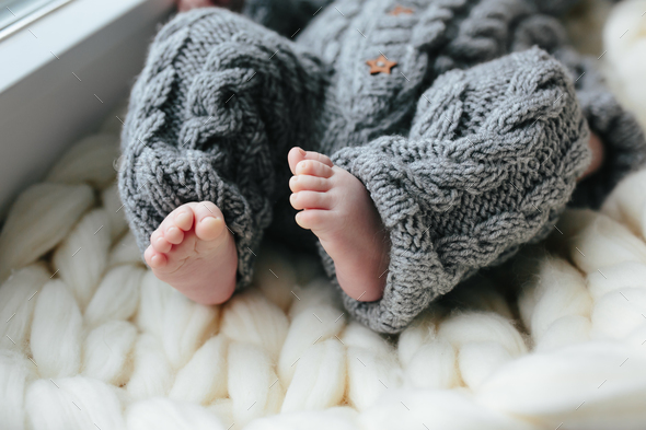 Small baby in knitted clothes - Stock Photo - Images